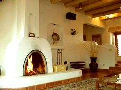Kiva fireplace & viga ceilings - very southwest
