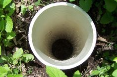 "Worm Tower - Drill lots of holes in a pvc pipe. Bury all but 6 inches in garden. Place kitchen scraps in the hole. Worms will come in and eat and then transfer the ""goodies"" throughout the garden. Clever!"