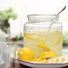 Lemonade  1 cup(s) sugar  6 large lemons, seeded and juiced    1.Bring the sugar and 1 cup of water to a boil in a small saucepan. Stir occasionally until sugar dissolves completely. Cool.  2.Stir the syrup, unstrained lemon juice, and 4 cups of cold water together in a large pitcher.  3.Chill. Serve over ice.