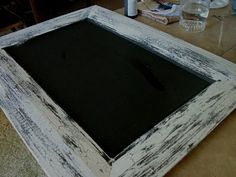 crackle edge with elmers glue and paint with chalk board center... on cupboard doors!