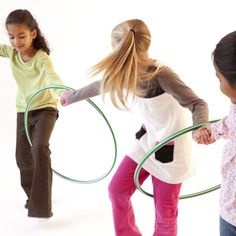 Ask the kids to stand in a big circle, slip a hula hoop onto one child's arm, and have them all join hands.  They then must find a way to move the hula hoop all the way around the circle without letting go of each other's hands.