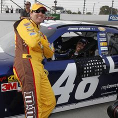 Kyle Busch, left, talks with Jimmie Johnson, in car, as they wait for results during qualifying for Sunday's Sprint Cup race at Martinsville Speedway in Martinsville, VA., Friday, Oct. 26, 2012. Jimmie Johnson won the pole with Kyle Busch finishing third. (AP Photo/Steve Helber) on Yahoo News.