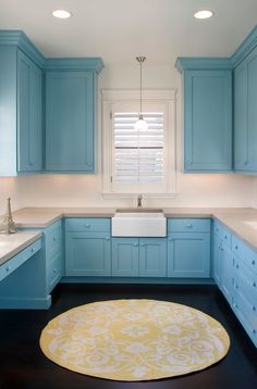 Baby blue kitchen.... wow with a desk, touches of yellow, a farm house sink, and dreamy floors!!!   Wow is right!
