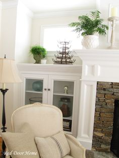 built-in 1/2 wall bookcases flanking the fireplace
