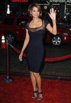 Halle Berry curves in a figure hugging black dress