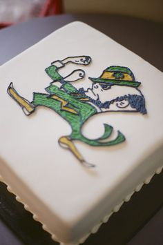 "... Fighting Irish"" Notre Dame Groom's Cake | Photo: JHenderson Studios"