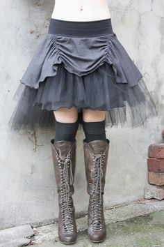 Steampunk skirt. Love the boots.