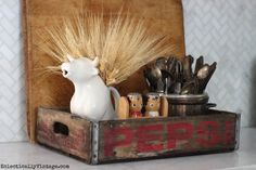 Love the old Pepsi crate in the kitchen filled with fun finds and the wheat from HomeGoods eclecticallyvintage.com #HomeGoodsHappy #HappybyDesign #sponsored
