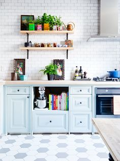9 Tips For Beautiful Organization // pale blue kitchen cabinets, subway cabinets, open shelving, hexagonal floor tiles, Le Creuset // traditional kitchens