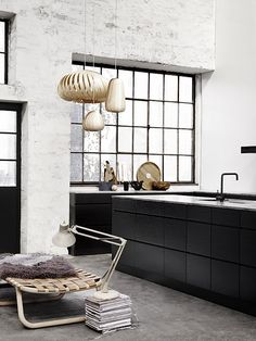 Love the textural mixes in this kitchen and the way the trio of pendants and the low woven seat complement each other - and soften the otherwise monochrome palette. Nice. @Zack Sheppard Sheppard Hedrick Magazine