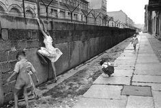 West German children play on the newly erected Berlin Wall, 1962