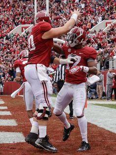 Alabama running back Kenyan Drake (17) celebrates with offensive linesman Ryan Kelly (70) after scoring on a 13-yard touchdown run. (Dave Martin/AP)