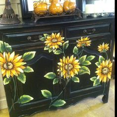 Cute painted hutch. Different flowers.