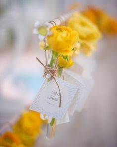 Attach fresh flowers to guest escort cards