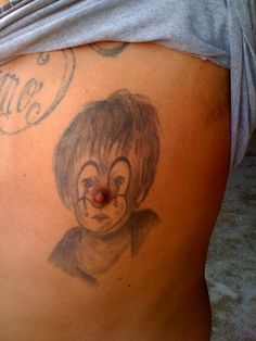 Wow. I'm not sure it gets much worse than a clown tattoo with your nipple as the nose. Now, that's the stuff of nightmares.