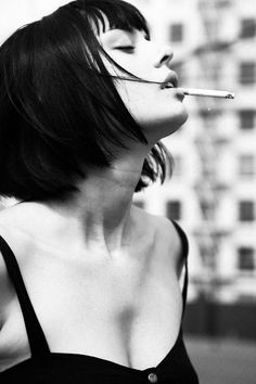 Girl Smoking Short Black Hair Bob Cut