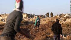 Palestinian youths throw stones at Israeli security forces Friday in a West Bank village near Bethlehem.