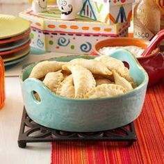 Mini Chicken Empanadas Recipe  1 c chopped cooked chicken  2/3 cup cheese  3 tablespoons Philadelphia® Cream Cheese  4 tsps chopped sweet red pepper  2 teaspoons chopped jalapeno  1 teaspoon ground cumin  1/2 tspn salt  1/8 tspn pepper  1 package (14.1 ounces) refrigerated pie pastry  Bake at 400° for 12-15 minutes or until golden brown