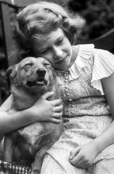 Princess Elizabeth II hugging a corgi, July 1936