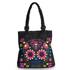 Blow minds and eye sockets with this blazing neon skull tote bag! The denim tote has embroidered details and a braided faux leather handle. #InkedShop #bag #sugarskull #dayofthedead #diadelosmuertos #purse #tote #fashion #style