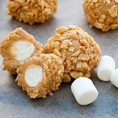 Marshmallows dipped in caramel, rolled in rice crispies. This recipe shows nuts, but rice crispies are the best.