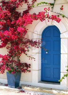 Pink Bougainvillea - boho european design -blue front door and red pink flower bush tree doorway house entrance boho arch moroccan interior design