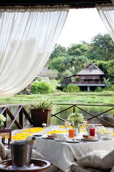 Breakfast for two (with a side of bubbly) is served amid the rice paddies at @Four Seasons Resort Chiang Mai.