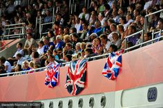 The crowd watched the cyclists intently at the Velodrome - London 2012 Paralympic Games