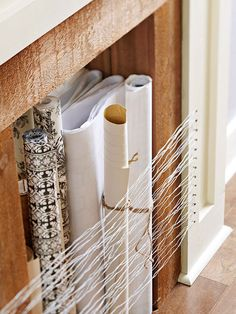Diy projects with thin wire for gardens - Out Of The Box Storage Thin Gauge Wire Strung Between Upholstery Tacks