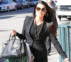 Kyle Richards heads to her KYLE shop with some clothing samples in Beverly Hills