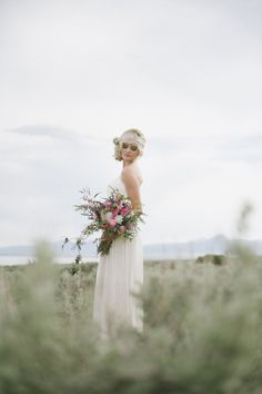 A beautiful bohemian bride and a wild bouquet.