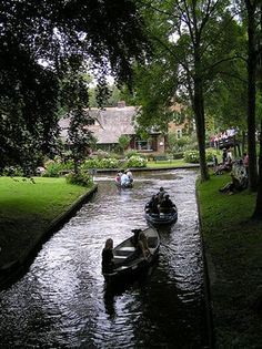 "giethoorn - a village in holland with no roads. visitors are always welcomed and encouraged to rent an electric and noiseless ""whisper boat"" to explore this little piece of heaven on earth. SO COOL!"