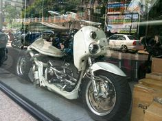 White Honda Ruckus custom with stacked off-center headlights and wide rear tire