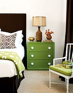 bedrooms -green nightstand chocolate brown velvet headboard bed skirt brown lattice pillow green throw cork lamp white faux bamboo chair green cushion chocolate brown silk drapes
