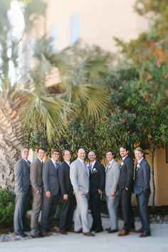 different suits in shades of gray - photo by http://www.awakeyoursoul.com - http://ruffledblog.com/one-world-theatre-wedding/
