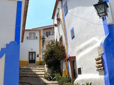 Top 25 Attractions & Things To Do In Portugal - via Open Travel | Portugal has everything you need plus a bunch of things to surprise you. The emerald waters of Algarve, the red-tiled roofs of Madeira, the soothing whiteness of Belem and the luscious greenness of the Azores are all for the taking. And so is the tranquility Alentejo's sleepy fishing villages, the rambling of trams in the narrow, ascending streets of Lisbon... Photo: Walled Town of Obidos honeymoon, favorit place, father grew, 3centro portug, portugal, obido portug, spainportug trip, portug monument