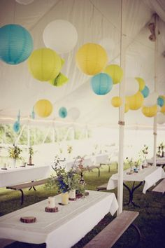 love the colorful (and inexpensive) paper lanterns and the rustic centerpieces