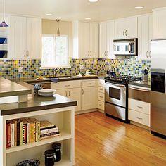 Kitchen, glass tile backsplash, book shelf, stainless.