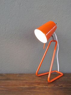 similar desk lamp in orange. Bedside.