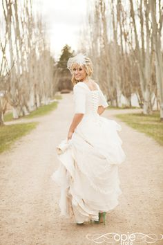 I love the elbow length sleeves, full skirt, and corset back. I think I might just steal this wedding dress. :P