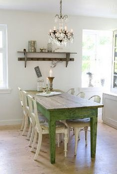 I love the painted green farm table with the white chairs