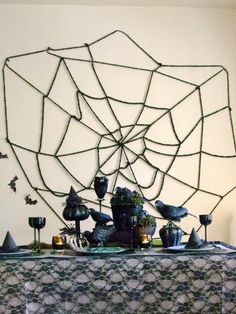 Get in the spooky Halloween spirit by making this easy DIY spider web. Wool yarn, scissors and tape are all that is needed to make this classic decoration. And spiders, of course!