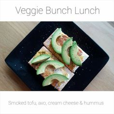 Simple vegetarian lunch. Avo, tofu, hummus and cream cheese on cracker bread