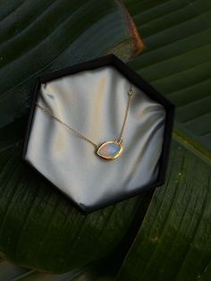 Wink necklace by CRWN Jewelry