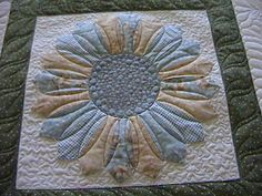 I love how the quilting has changed this dresden plate into a sunflower
