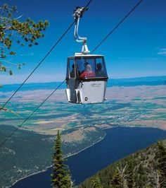 """Wallowa Lake Tramway, Joseph OR. Experience the """"Alps of Oregon"""" first-hand in the steepest vertical gondola ride in N. A. Open May – Sept and during the winter months for special occasions! In just under 15 min. you are taken on a 3700' ascent to the summit of Mt. Howard where you'll be treated to awe-inspiring views of the Wallowa Valley/ wilderness/ the distant Seven Devil Mnts in Idaho.  Dine at the Summit Grill Alpine Patio"""
