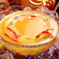 Freeze gummy worms in ice to make this festive Halloween punch.
