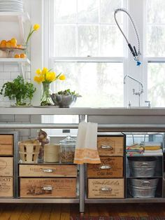 Add drawer pulls to wooden crates to create unique kitchen storage. More stylish storage ideas: http://www.bhg.com/decorating/storage/organization-basics/charming-hardworking-storage/#page=7