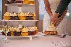 Cutting the (mega) wedding cupcake together! Adorable | photo credit Richard Bell Photography #CupcakeDownSouth #WeddingCupcakes #SouthCarolina