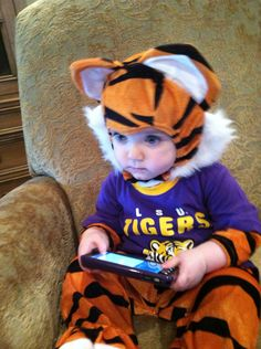 A Tiger watches his #LSU Tigers.